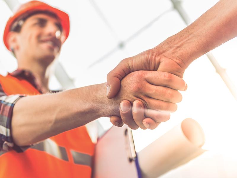 construction worker shaking hands